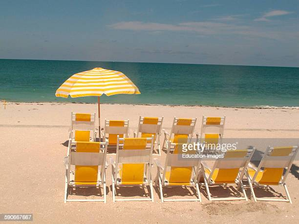 Beach chairs are lined up at the Gasparilla Inn and Club in Boca Grande Florida This a private beach club for guests and members