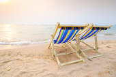 Beach chairs on perfect tropical white sand beach.