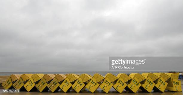 Beach chairs stand ready to be transported away from the beach of CuxhavenDoese northwestern Germany on October 7 2017 / AFP PHOTO / dpa / Carmen...