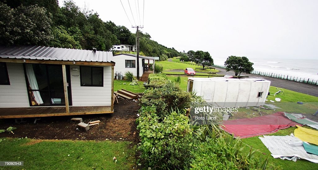 A beach cottage sits off its foundations and a caravan lies on its side after last tornadoes hit the area on July 6 2007 in the seaside town of...
