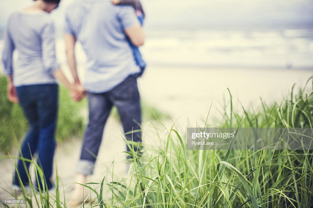 Beach Family and Grass : Stock Photo