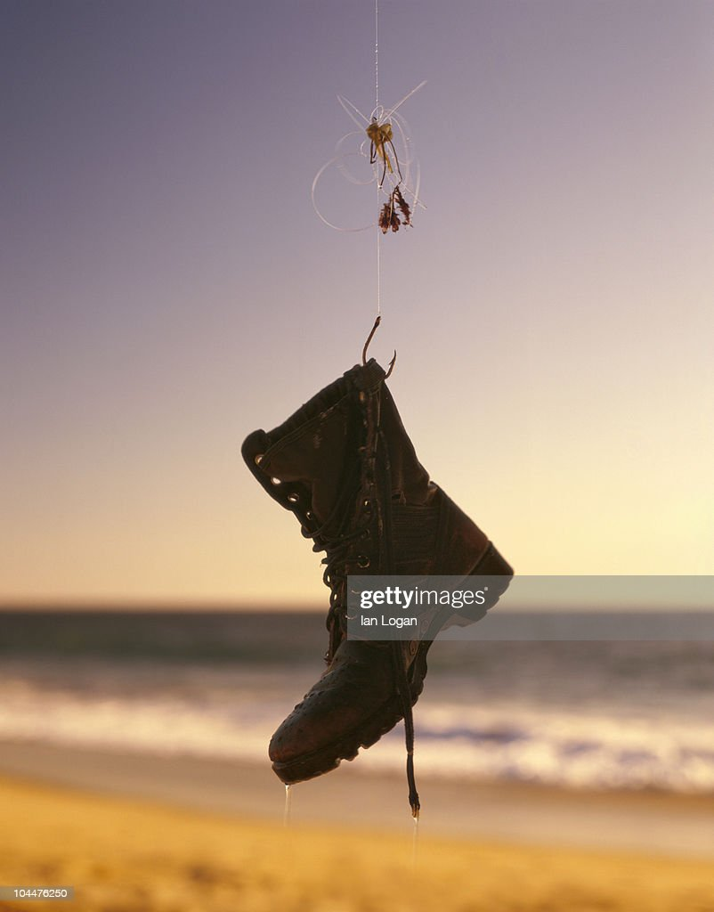 Beach fishing with boot on the hook