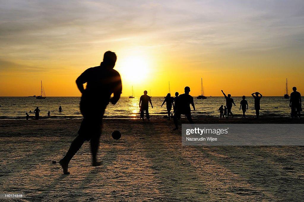Beach football in silhouette : Stock Photo