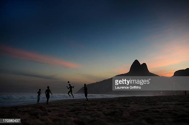 Beach football is played on Impanema Beach at sunset on June 11 2013 in Rio de Janeiro Brazil