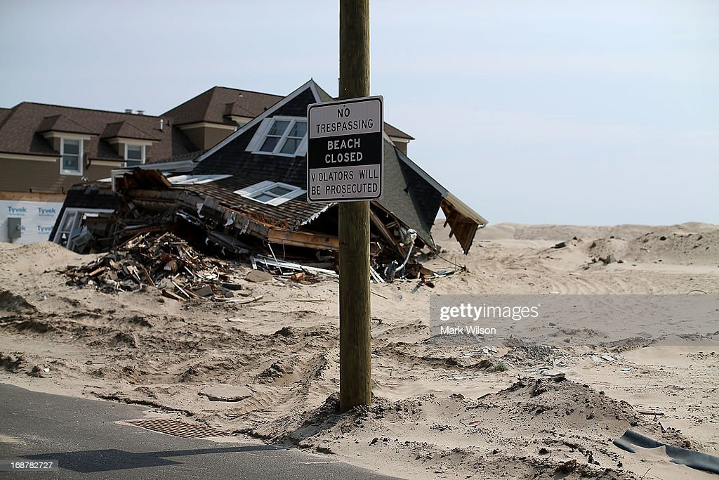 A beach front home damaged by Superstorm Sandy is tagged to be torn down and hauled off, May 15, 2013 in Manotoloking, New Jersey. Mantoloking officials say that at least 50 homes are scheduled to be demolished in the up coming weeks.