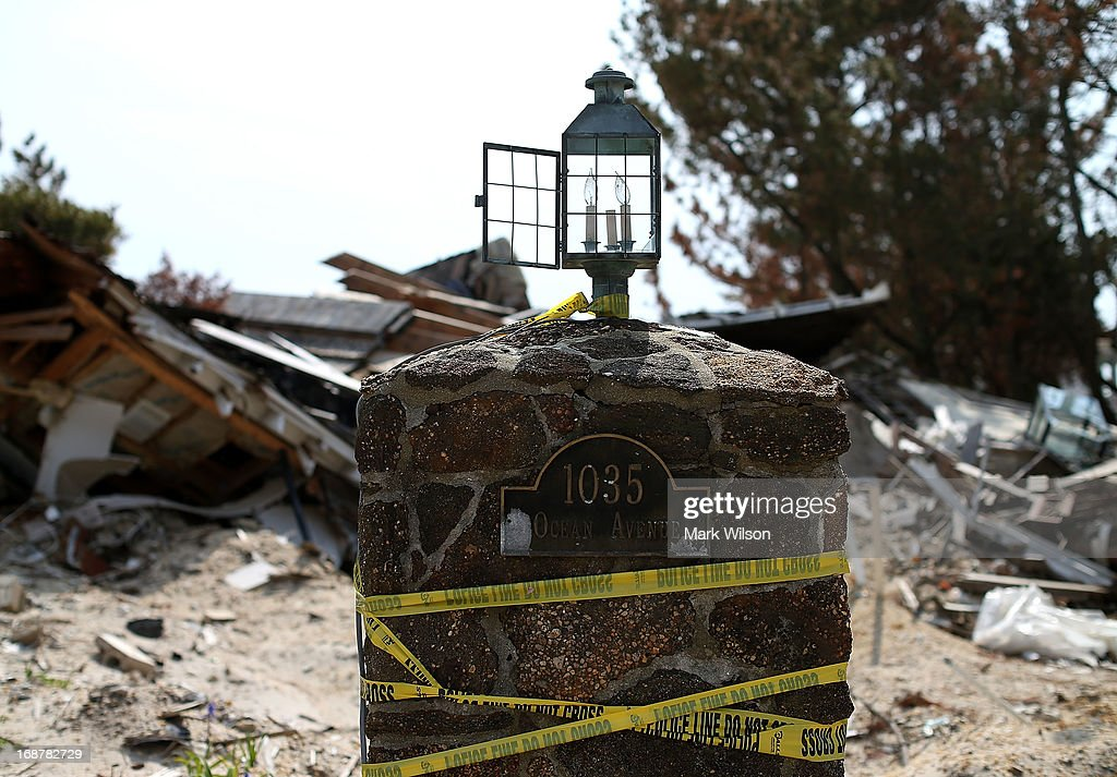 A beach front home that was demolished by Superstorm Sandy is now a pile of debris and is sheduled to be hauled off, May 15, 2013 in Manotoloking, New Jersey. Mantoloking officials say that at least 50 homes are scheduled to be demolished in the up coming weeks.