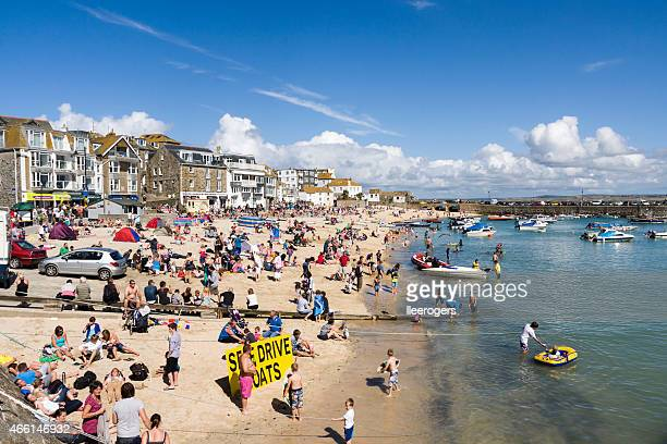 Beach goers enjoying Harbour beach in St Ives