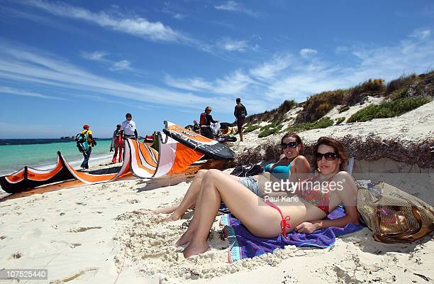 Beach goers look on as competitors warm up prior to the start of the Red Bull Lighthouse to Leighton Kitesurfing race on December 11 2010 in Perth...
