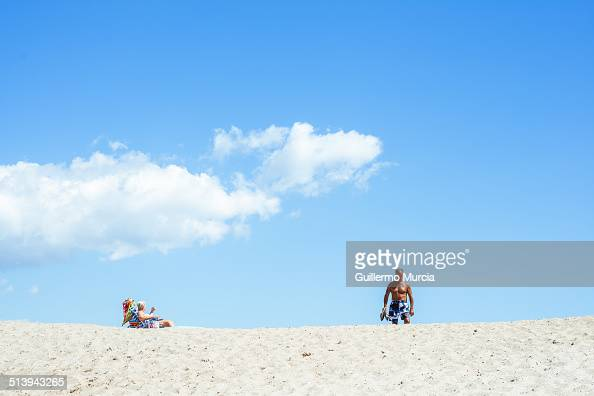 Beach goers of all ages enjoy the Rockaway Beach in Queens New York August 24 2014