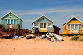 Beach huts and boats by the sea