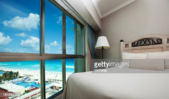 Beach Hotel Room with Scenic Caribbean Sea View through Window