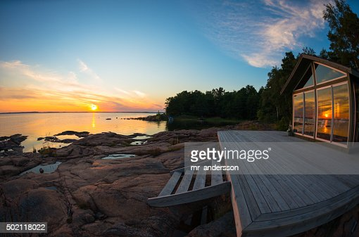 Beach house terrace at summer sunset : Stock Photo