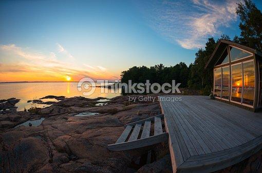 Beach house terraza en verano puesta de : Foto de stock