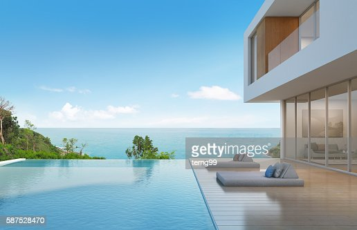 Beach house with pool in modern design : Stock Photo