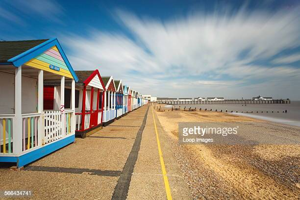 Beach huts at Southwold with the pier in the distance