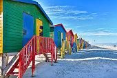 Beach huts beside the surf at Muizenberg beach