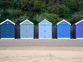 Blue holiday beach huts.