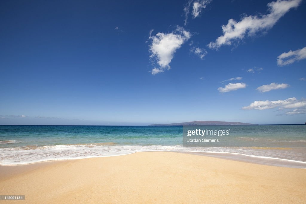 beach, ocean and clounds on tropical island.
