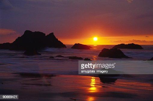 Landscape Boulders Orange County Ca : Beach ocean sunset tide boulders landscape stock photo getty images