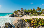 The beach and ruins of the Maya civilization in Tulum on a sunny day, Mexico.