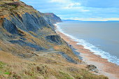 Beach on the Jurassic Coast near village of Charmouth famous by fossils