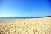 The wide sands and calm sea of Bournemouth beach, early one August morning