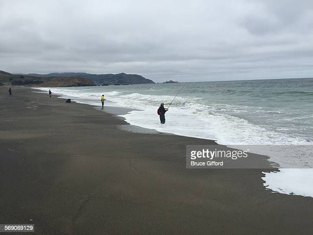 Beach People fishermen Pacifica Beach Pacifica California July 13 2015