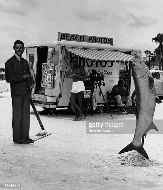A Beach Photos stand with a standee of Clark Gable and a large fish 1954