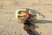 beach pollution, spilled oil can