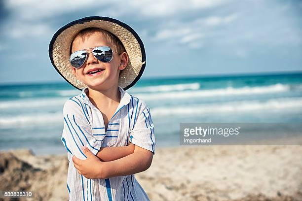 Beach portrait of a laughing little boy