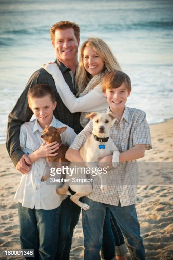beach portrait of family and their dogs : Stock Photo