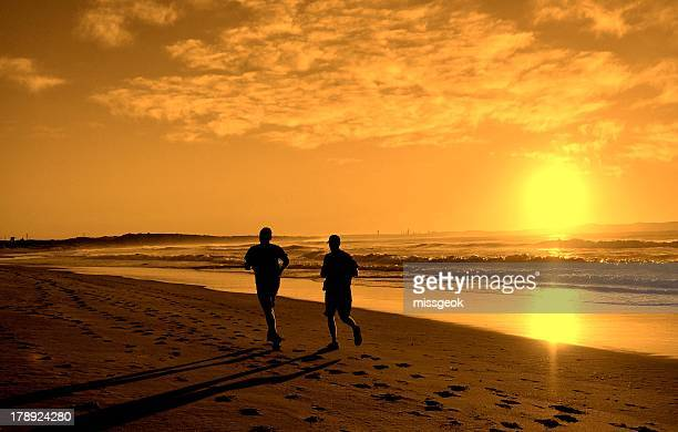 Beach Runners at Sunrise