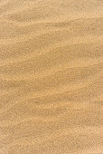 Wave pattern brown colored sand background texture