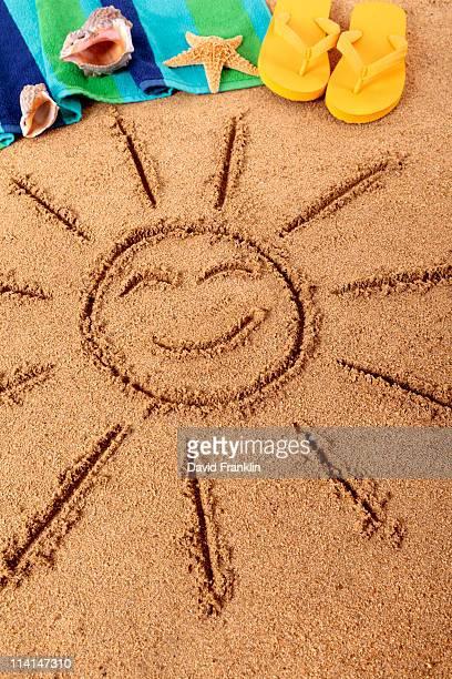Beach scene with smiling sun