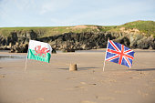 Beach, sea, sandcastle and  Welsh Flag with Union Jack