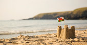 Beach, sea, sandcastle and  Welsh Flag
