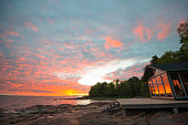Summer beach cottage on Åland Islands in Finland at sunset