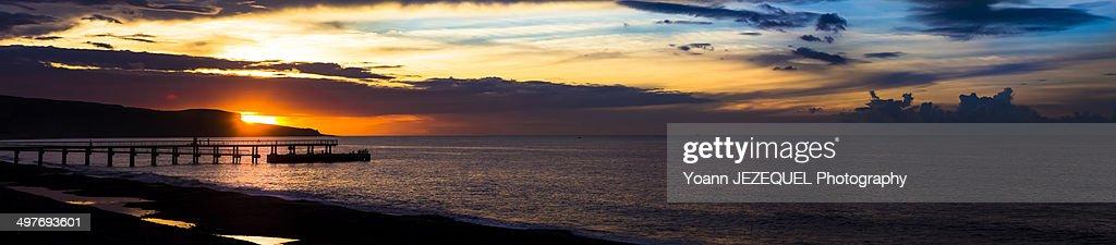 Beach sunset on the sea with pontoon : Photo