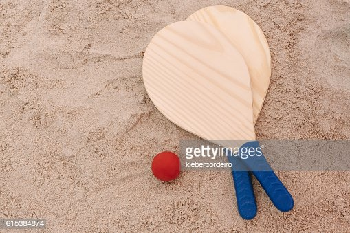 Beach tennis, beach paddle ball, matkot. Beach rackets and ball : Stock Photo