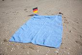 beach towel and German flag