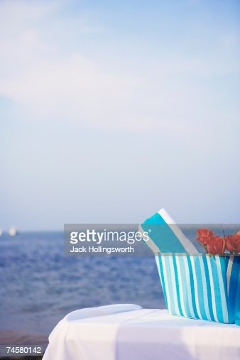 Beach towel and roses at beach : Stock Photo