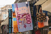 A beach towel depicting a 500 Euro note is seen for sale outside a souvenir shop on July 7 2015 in Athens Greece Greek Prime Minister Alexis Tsipras...