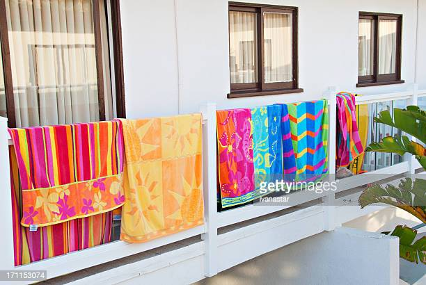 Beach Towels Hanging on Hotel Balcony