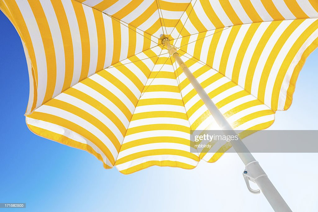 Beach umbrella against blue morning sky