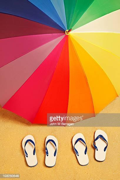 Beach umbrella and flip flops
