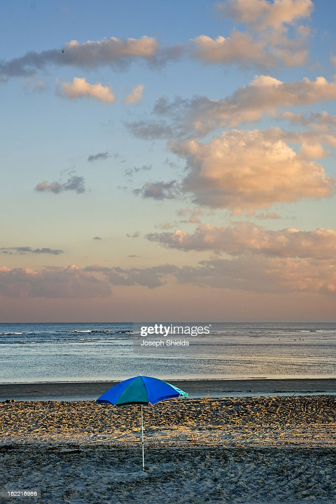 Beach umbrella in late afternoon light