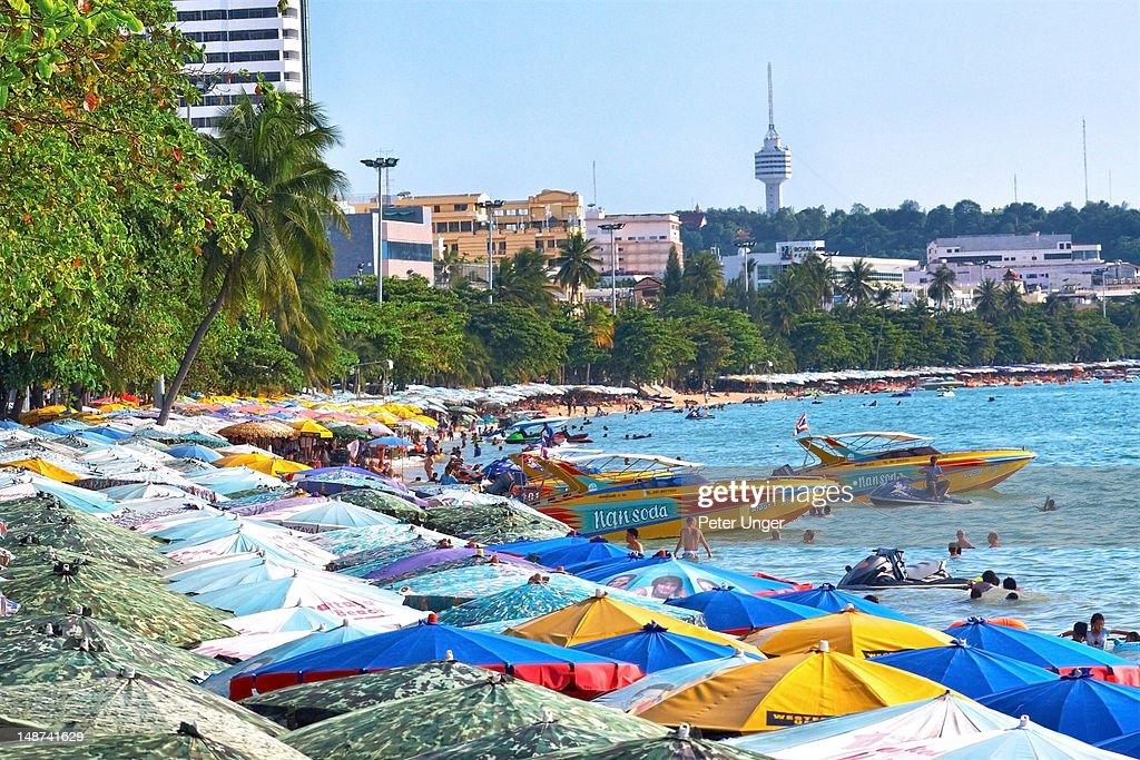 Beach umbrellas and boats on Beach Road beachfront.