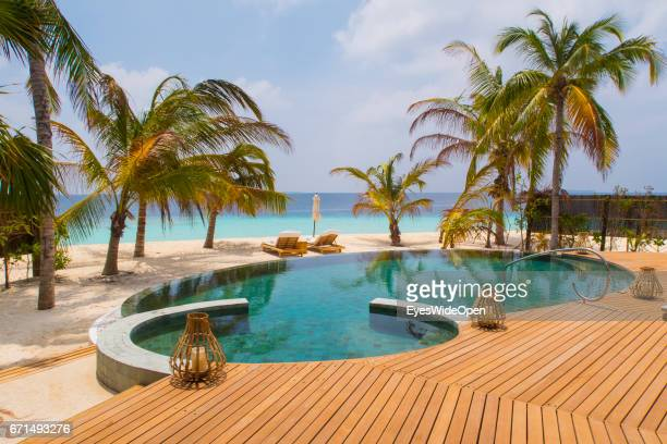 Beach Villa with Swimming Pool and Palm Trees a Lifestyle Resort Milaidhoo Island BaaAtoll on February 22 2017 in Male Maldives