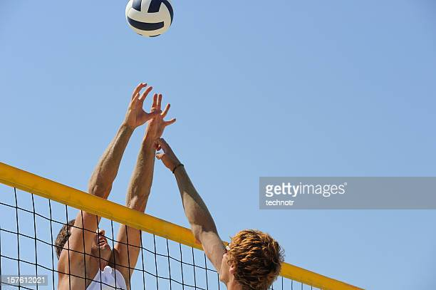 Beach volley block action on the net