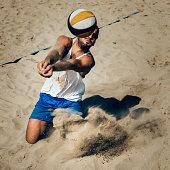 Beach volleyball dig